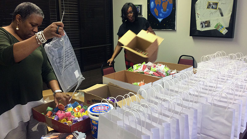 CK Post Adoption Staff Preparing Gift Bags